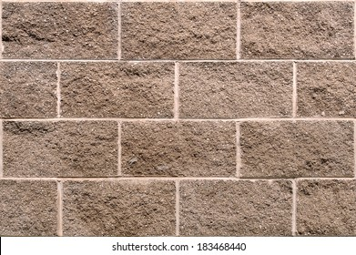 Concrete Cinderblock wall as a seamless, repeating, tile background.