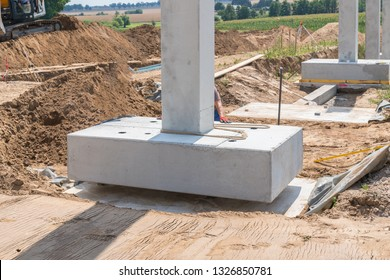 a concrete column is placed on a foundation