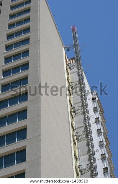 Concrete construction tower with elevator