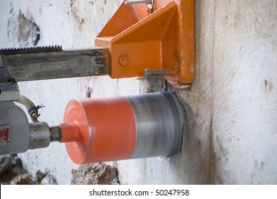 Concrete core drilling machine on a building construction site