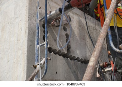 A lot of concrete coring holes by diamond core bit to make a big opening in concrete wall