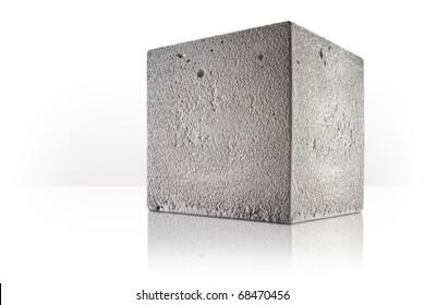 concrete cube over white background
