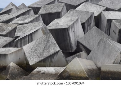 Concrete cubes used as breakwaters to protect the seaport. - Shutterstock ID 1807091074