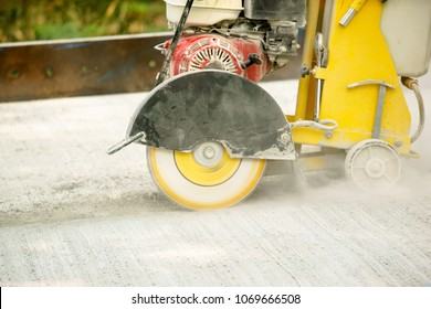 Concrete cutter machine is cutting the concrete road in to groove befor pour the asphalt.