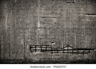 Concrete devastated wall with visible rebar.