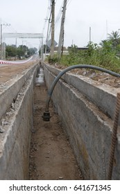 Concrete Drainage channel on a Construction Site .Concrete pipe stacked sewage water system aligned on site.