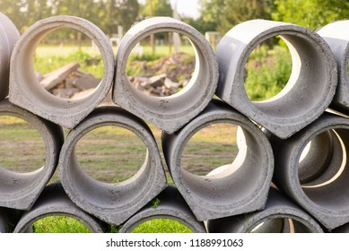 Concrete drainage pipes are stacked together