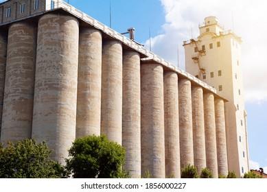 Concrete elevator, grain tank on a sunny sky background