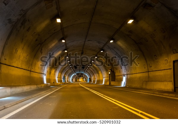 Concrete empty dark road tunnel