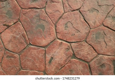 The concrete floor decorated the skin surface like a red stone.