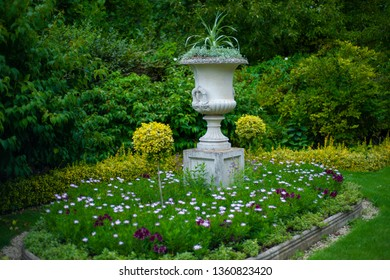 A concrete flower bed in the park.