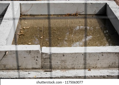 Concrete foundation of the building behind the fence