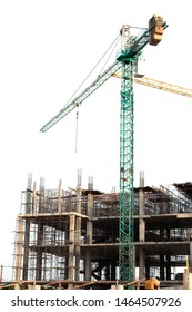 Concrete foundation of high rise building with full green tower crane in white background,no worker low angle view.Construction site with steel scaffolding,shallow depth of field.