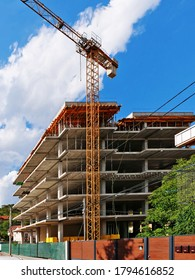 Concrete frame structure of a new multi-story apartment building in construction and crane, vertical