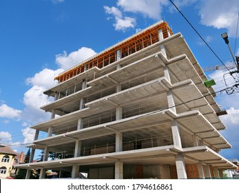 Concrete frame structure of a new multi-story apartment building in construction
