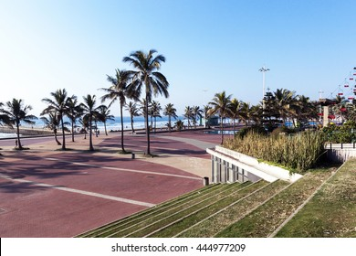 Concrete and grass stepped terrace and paved promenade on Golden Mile beach front in Durban, South Africa