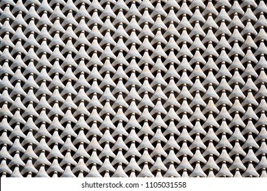 Concrete grate on the house facade. Full frame, white color