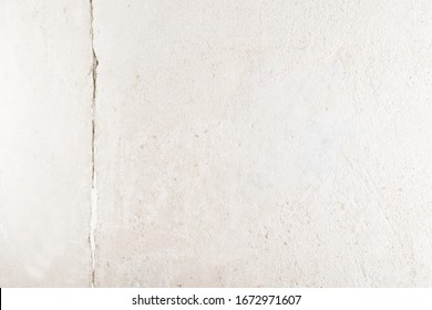 concrete gray wall with cracked, place for inscription on the right