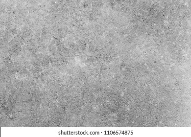 Concrete gray and white background of natural cement or stone texture on a wall or floor.