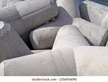 concrete interlocking tetrapods used to prevent coastal erosion placed on a shoreline