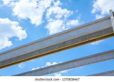 Concrete joists are assembled into construction of huge edifice.