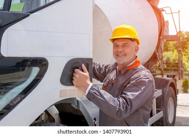 Concrete mixer truck driver with hard hat