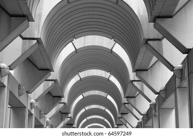 Concrete modern arched hallway ceiling diminishing in the distance