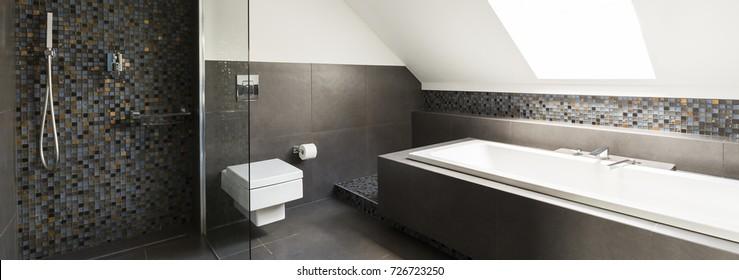 Concrete modern bathroom design with little decorative tiles