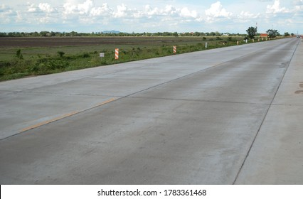 Concrete pavement road with longitudinal joint and construction joint.Empty concrete road.