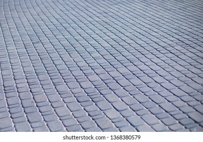 Concrete paving slab flagstone. Sidewalk pavement pattern.Texture of gray patterned paving tiles on the street, perspective view. Concrete paver block floor pattern for background.