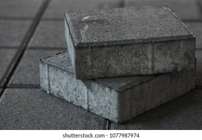 Concrete Paving slabs factory. Tiles piled in pallets, close-up, selective focus. Warehouse paving slabs in the factory for its production