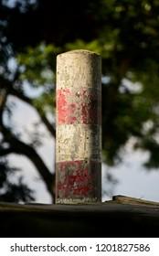 A concrete pillar with dark background unique photo