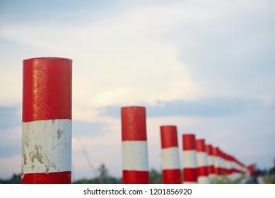 Concrete pillars beside a road isolated unique photo