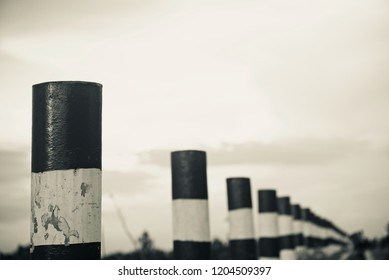 Concrete pillars beside an urban street unique photo