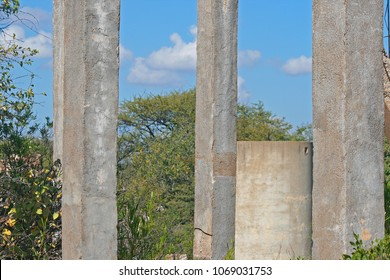 CONCRETE PILLARS IN OLD RUINS