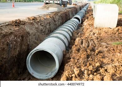 concrete pipeline construction site along the road