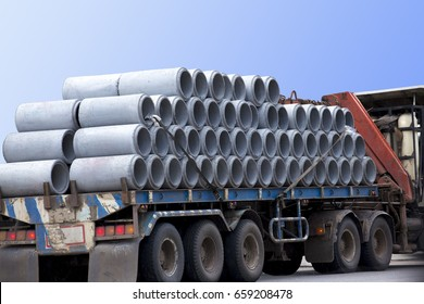 Concrete pipes on trailer prepare to deliver to construction site.