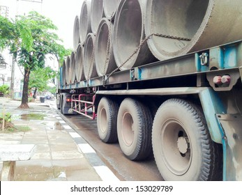 concrete pipes on the truck stop at the rode side