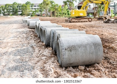 Concrete pipes stack in row line for road work construction.