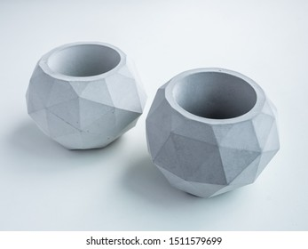 Concrete pot. Top view of two empty modern geometric concrete planters isolated on white background with copy space.