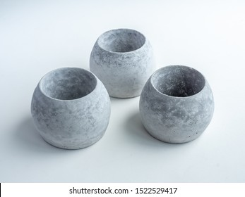 Concrete pots. Empty three modern round concrete planters isolated on white background top view.