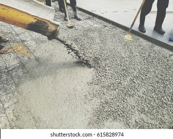 Concrete pouring during commercial concreting of building / Made from light photo graphic / soft focus / selective focus