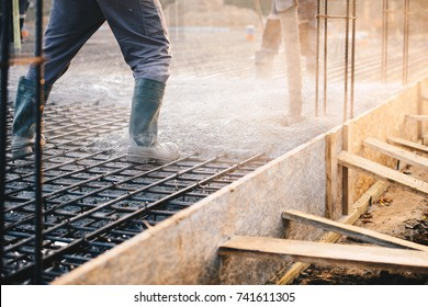 Concrete pouring during commercial concreting floors of buildings in construction - concrete slab