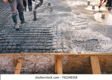 Concrete pouring during commercial concreting floors of buildings in construction - concrete slab - foundation construction