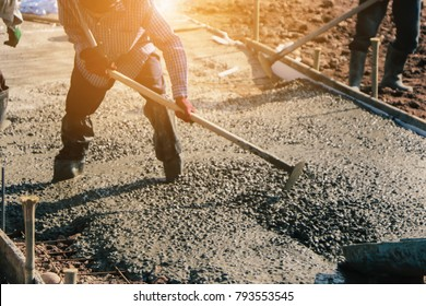 Concrete pouring during commercial concreting floors of road