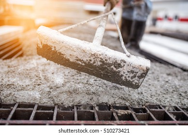 Concrete pouring tool during commercial concreting floors of building