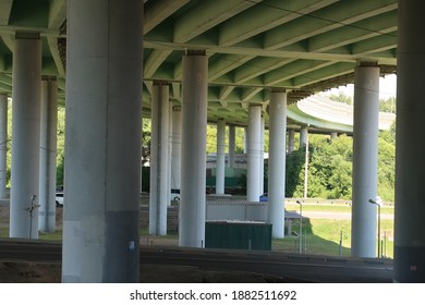 Concrete pylons of curved car overpass, summer