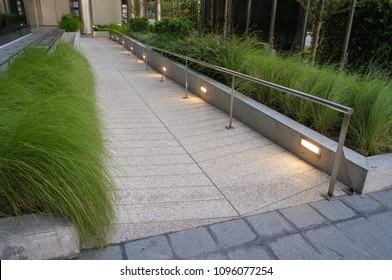 Concrete ramp way for support wheelchair disabled people in front of the hospital building.