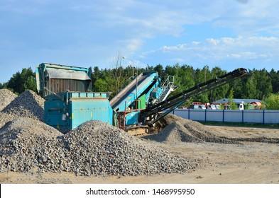 Concrete recycling shredding machine. Modern building techniques concrete processing, crusher and processing asphalt concrete, stones and rebar shredder. Reinforced concrete mobile shredder - Image