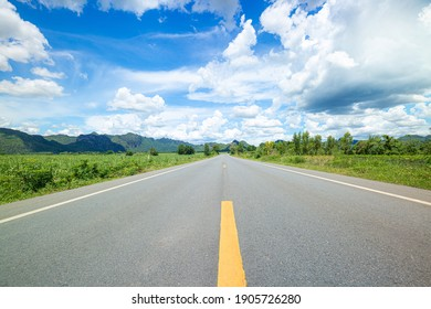 Concrete road with mountains and sky